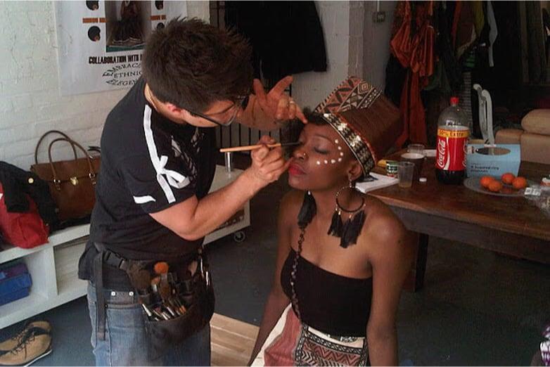 Makeup Man at work on film set